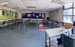 Teachers prep for in person learning by decluttering their rooms and arranging desks six feet apart.